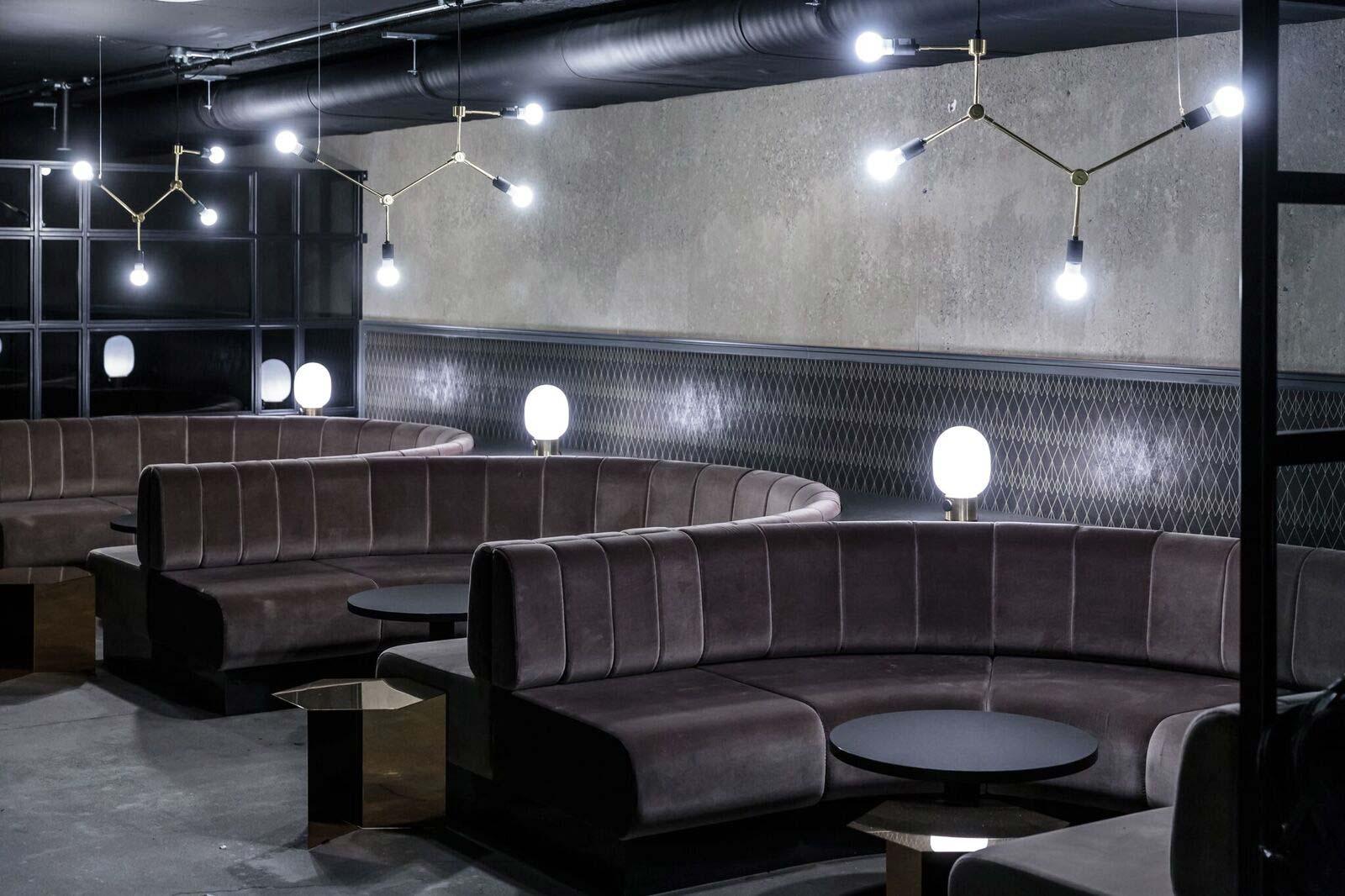 Velvet banquette seating, upholstered with fluted backs