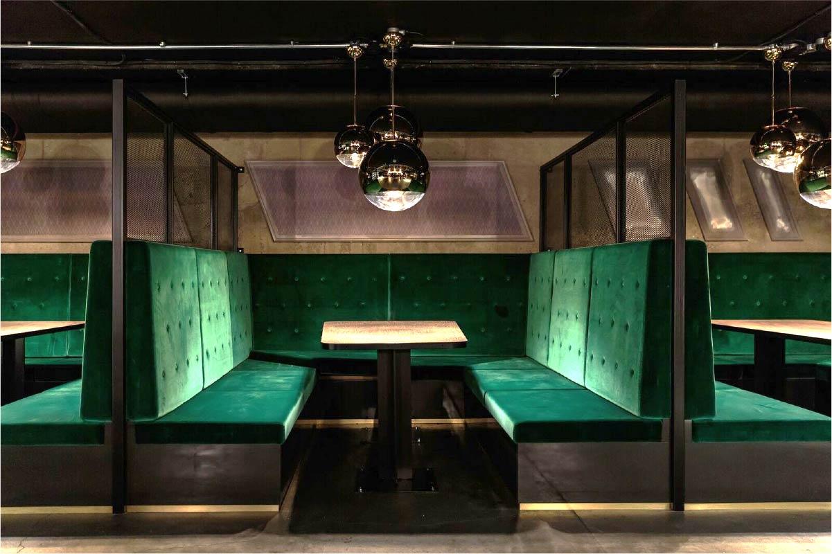 Bespoke green velvet restaurant booth seating upholstery