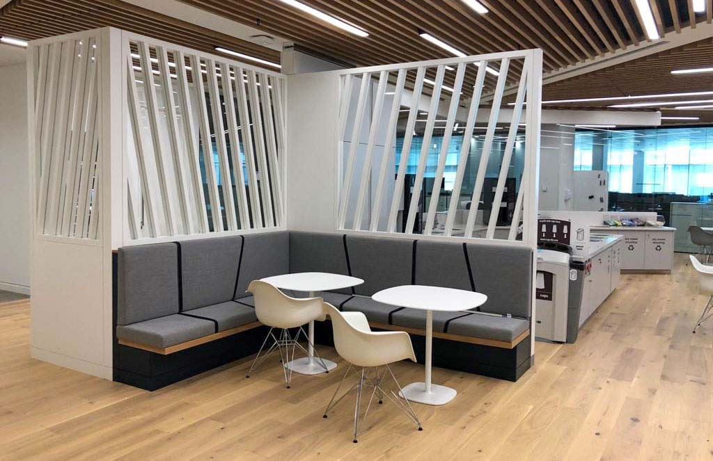 Open booth seating with bespoke, angled fabric upholstery