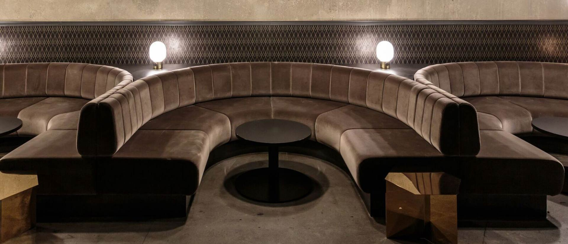 Brown velvet upholstered booth seating