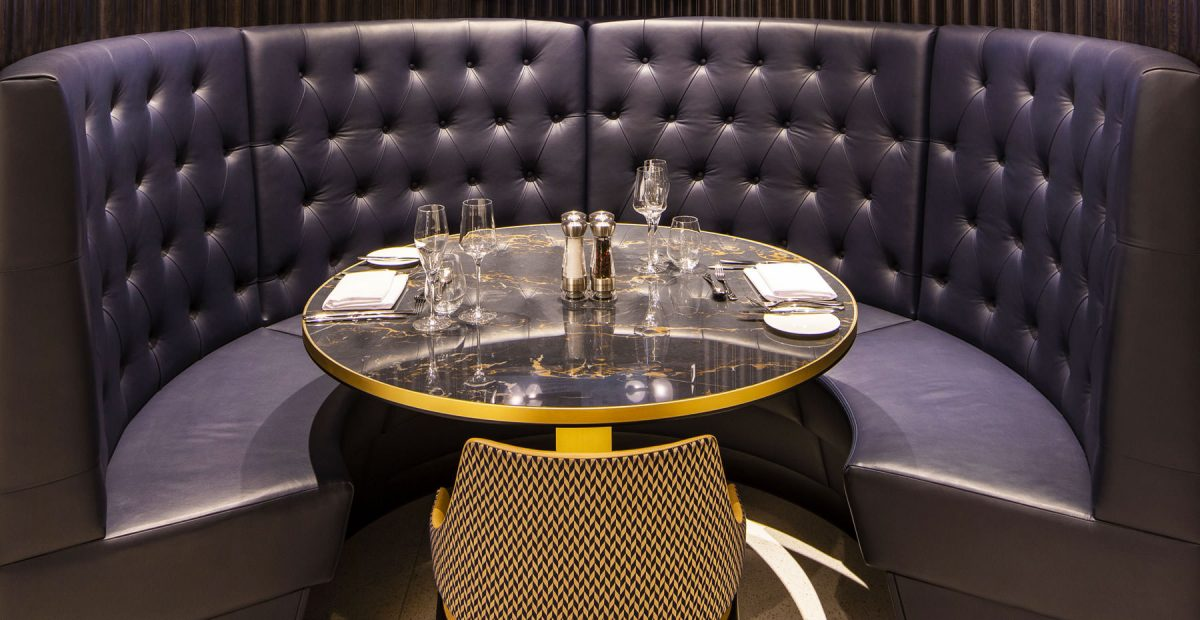 Tottenham FC hospitality buttoned leather booth seating